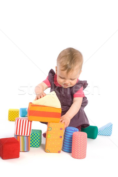 Baby palying with toy blocks Stock photo © nyul