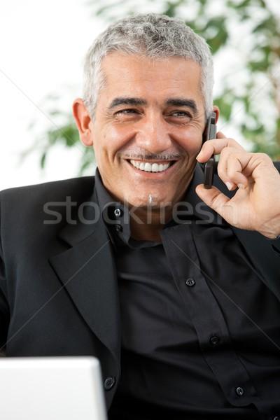 Homme appelant téléphone heureux homme mûr téléphone portable Photo stock © nyul