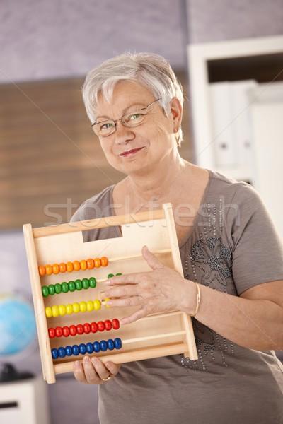 Idős tanár tart abakusz áll osztályterem Stock fotó © nyul
