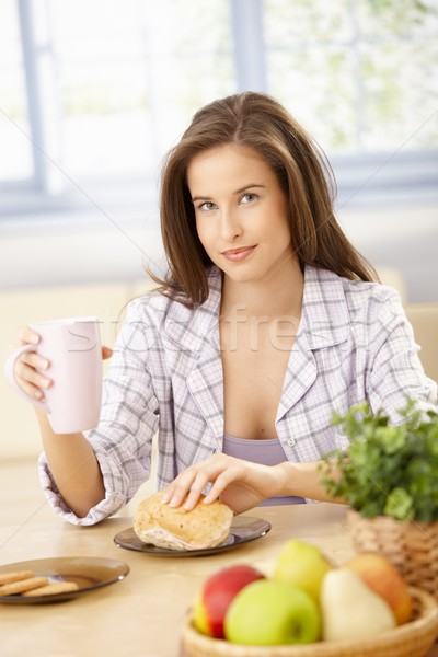 Smiling woman eating breakfast Stock photo © nyul
