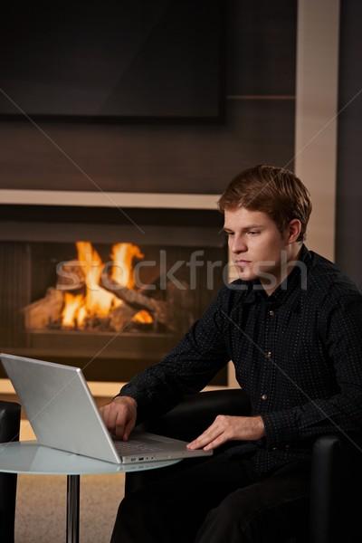 Man using computer at home Stock photo © nyul
