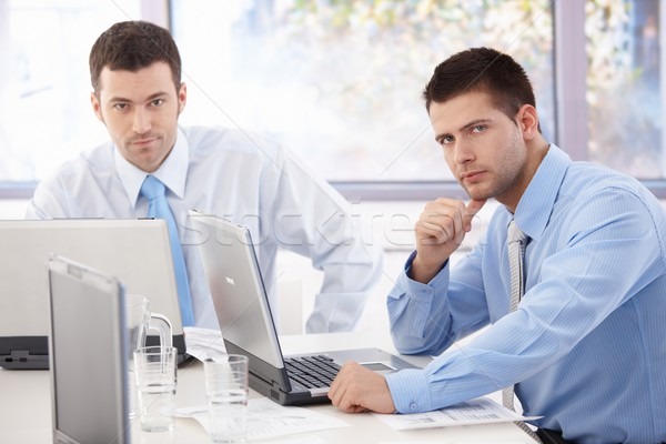 Young businessmen working at meeting table Stock photo © nyul