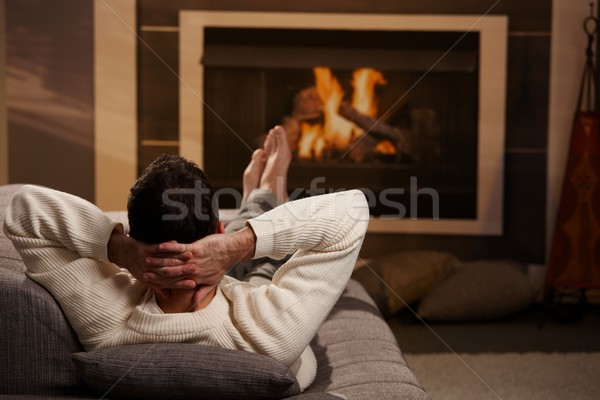 Man sitting at fireplace Stock photo © nyul