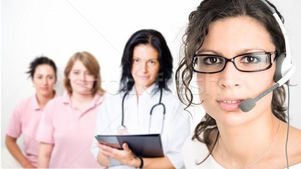 Clínica recepcionista fone jovem feminino Foto stock © nyul