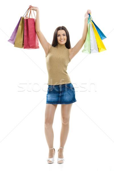 Nő bevásárlótáskák boldog fiatal nő visel miniszoknya Stock fotó © nyul