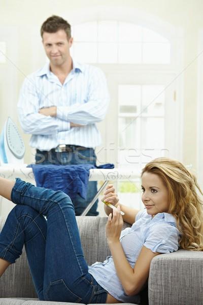 Aile hayatı genç kadın oturma kanepe çivi Stok fotoğraf © nyul
