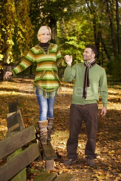 Happy couple walking in autumn park Stock photo © nyul