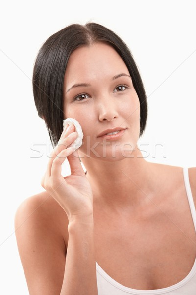 Stock photo: Beautiful woman cleaning face