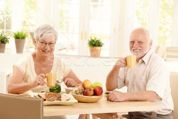 Stock photo: Senior couple having tea at breakfast