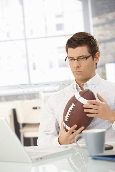 Határozott üzletember iroda futball munka gondolkodik Stock fotó © nyul
