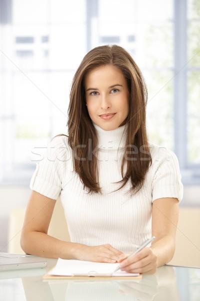 Portrait élégante femme prendre des notes bureau souriant Photo stock © nyul