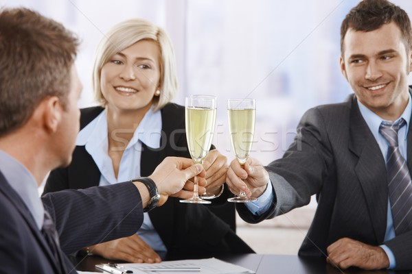 Business people celebrating with champagne Stock photo © nyul