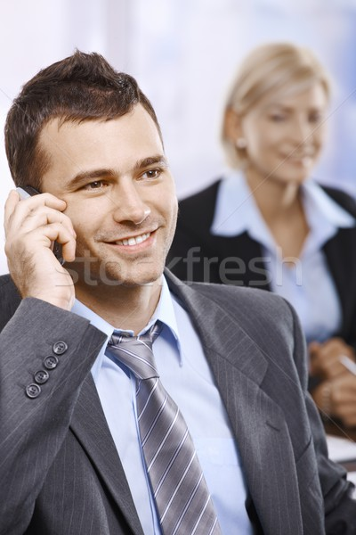 Empresario teléfono oficina hablar sonriendo mirando Foto stock © nyul