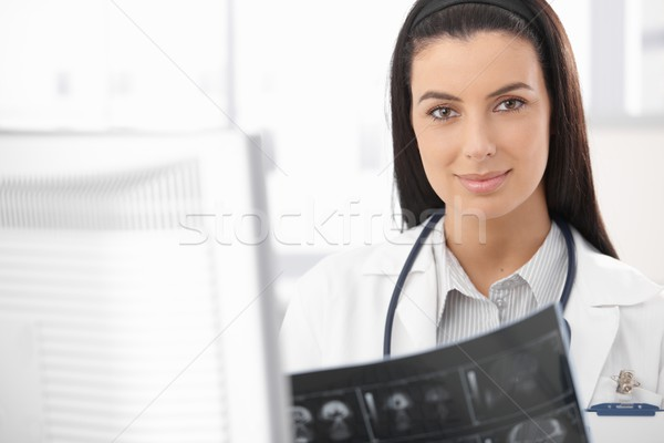 Smiling doctor busy with xray Stock photo © nyul