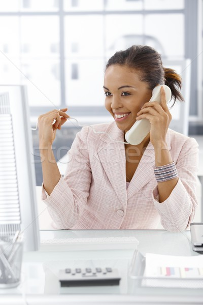 Happy businesswoman on phone call Stock photo © nyul