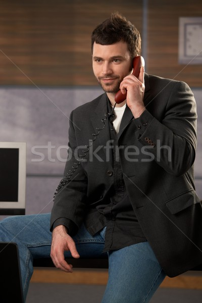 Businessman using landline Stock photo © nyul