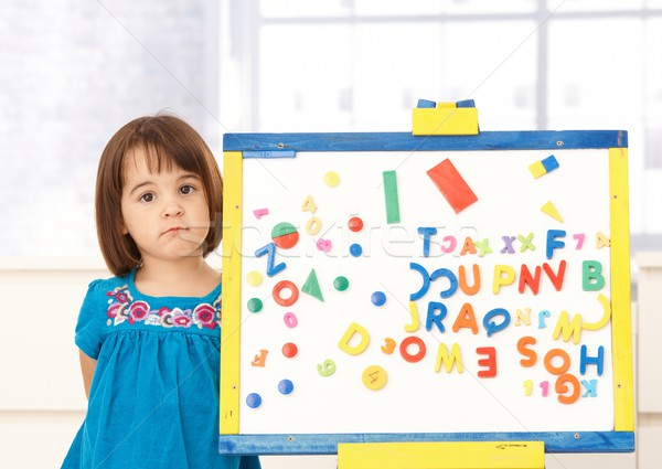 Sweet small girl standing at drawing board Stock photo © nyul