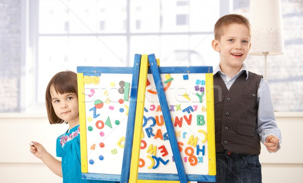 Stock photo: Happy kids playing with drawing board