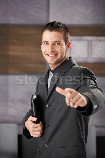 Exitoso empresario sonriendo jóvenes felizmente negocios Foto stock © nyul