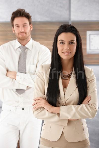 довольно деловая женщина улыбаясь оружия Постоянный Сток-фото © nyul