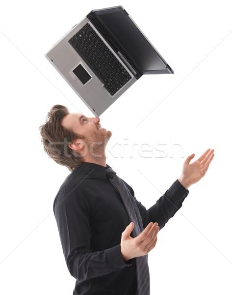Stok fotoğraf: Mutlu · adam · dengeleme · dizüstü · bilgisayar · genç · burun