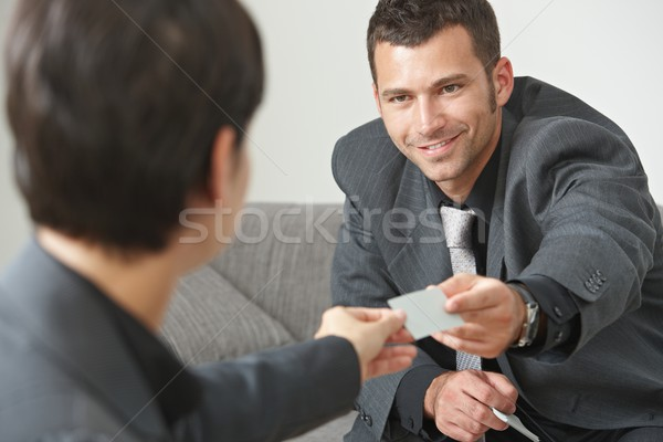 Business people changing cards Stock photo © nyul