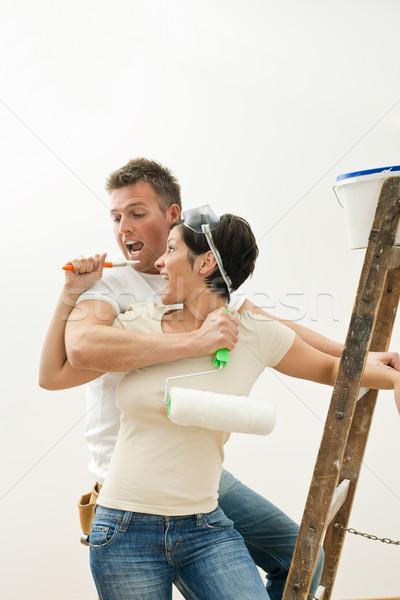 Stock fotó: Boldog · pár · festmény · fiatal · pér · átkarol · szórakozás