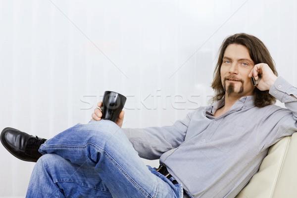 Stok fotoğraf: Adam · konuşma · cep · telefonu · oturma · kanepe