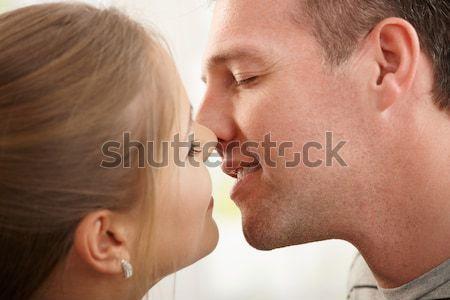 Сток-фото: пару · поцелуй · улыбаясь · человека · женщину