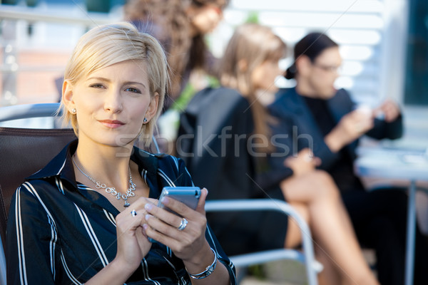 Businesswoman using smart phone Stock photo © nyul