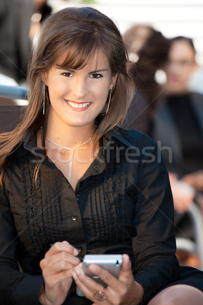 Businesswoman using mobile phone Stock photo © nyul