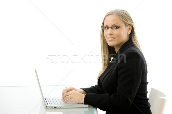 Businesswoman working on laptop Stock photo © nyul