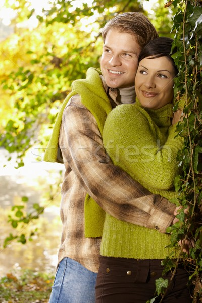 Portrait of young couple in autumn park Stock photo © nyul