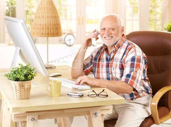 Happy old man on landline call Stock photo © nyul
