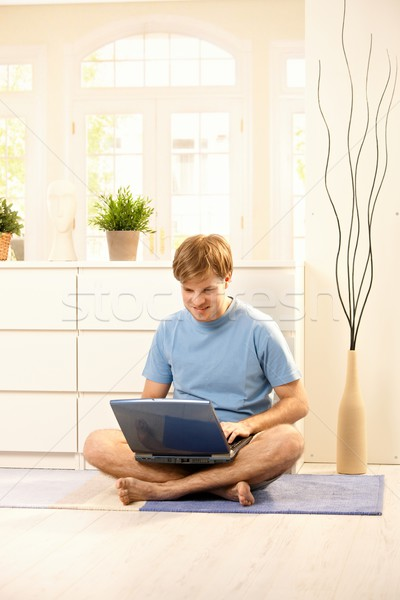 Guy with computer Stock photo © nyul