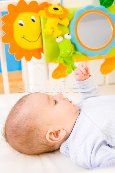 Baby playing in bed Stock photo © nyul