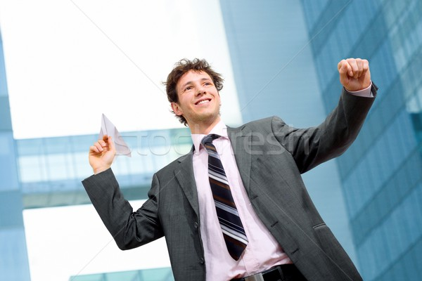 Businessman throwing paper airplane Stock photo © nyul