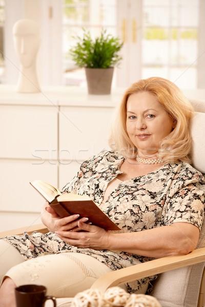 Stock photo: Elderly woman reading book