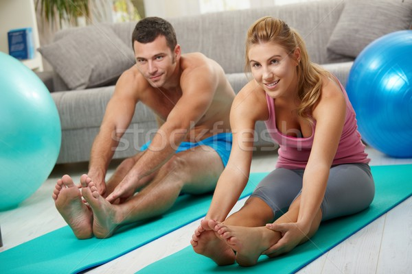 Couple streching legs before exercises Stock photo © nyul