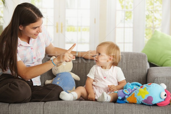Mother teaching babygirl Stock photo © nyul