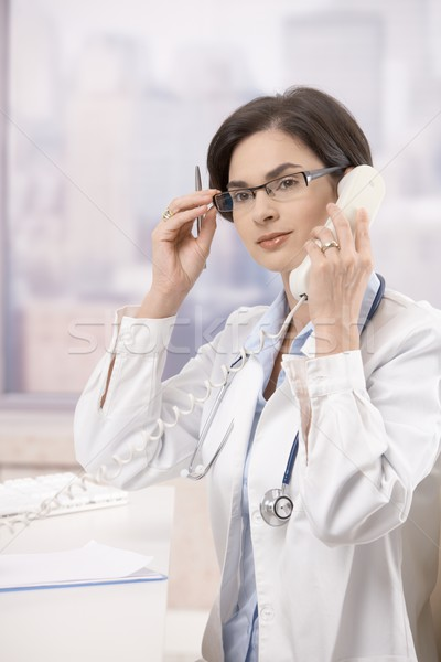 Young doctor answering phone call Stock photo © nyul