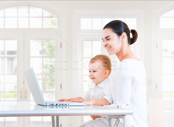 Mother and baby using laptop Stock photo © nyul