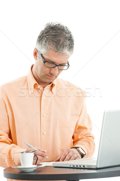 Casual businessman writing Stock photo © nyul