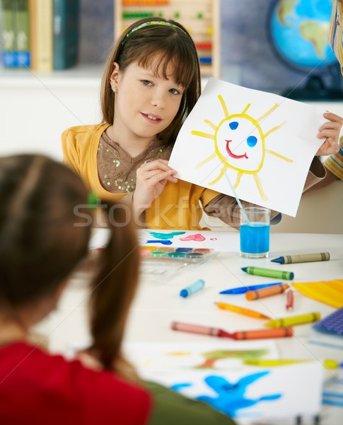Schoolgirl showing painting in art class Stock photo © nyul