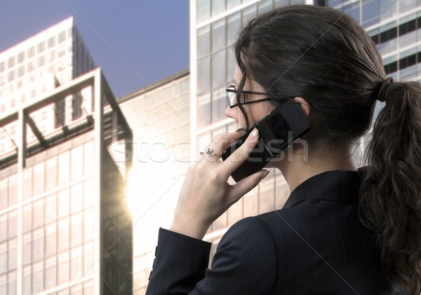 Young businesswoman talks on mobile Stock photo © nyul
