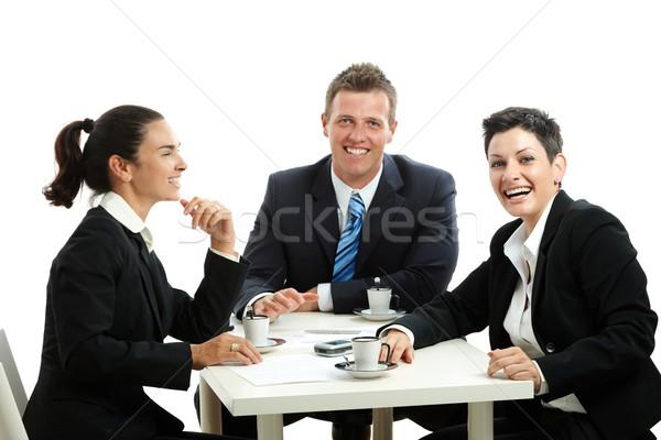 молодые сидят таблице изолированный Сток-фото © nyul