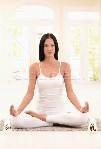 Attractive woman practicing yoga Stock photo © nyul