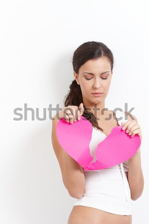 Heart-broken woman with a paper heart Stock photo © nyul
