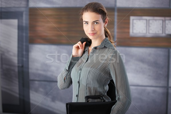 Young businesswoman standing in office lobby Stock photo © nyul