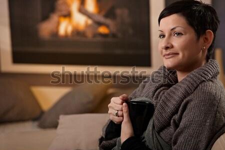 Stock fotó: Nő · kandalló · ül · kanapé · otthon · hideg